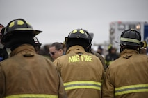 Firefighters of the 166th Civil Engineer Squadron huddle prior to the kick-off of Operation Blue Skywalker, April 10, 2019 at Delaware National Guard Base, Del. The operation, a simulated airplane crash, was a full-scale drill required by the Federal Aviation Administration to be held every three years. (U.S. Air Force photo by Mr. Mitch Topal)
