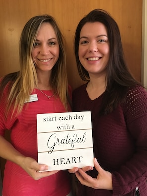 Michelle Jones and Anna Orlov, both Civilian Health Promotion Services coordinators, pose with a gratitude sign.