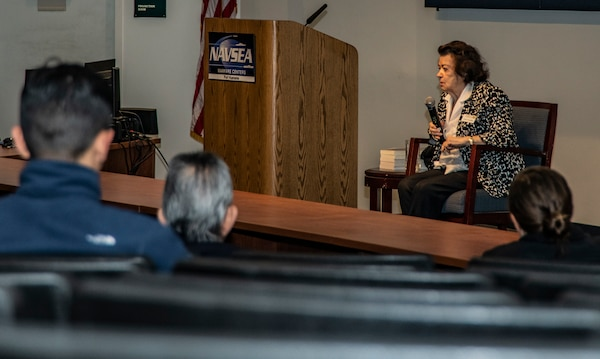 Clara Knopfler tells her story of survival from the Holocaust to personnel assigned to Naval Surface Warfare Center, Port Hueneme Division, as part of the command's Holocaust Remembrance event, April 23.