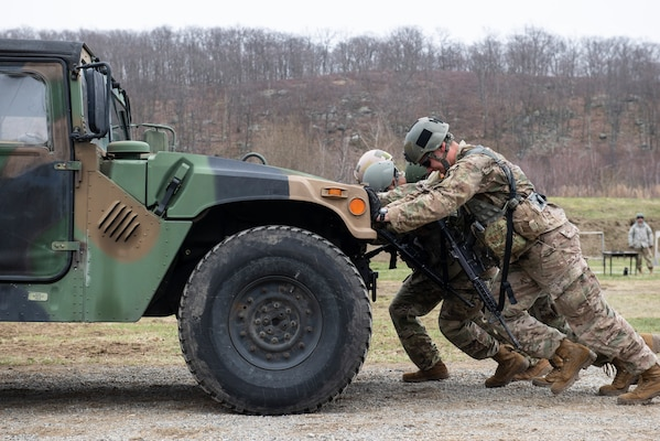 Army ROTC cadets push a Humvee between designated areas to earn points for this challenge during the 51st annual Sandhurst Military Skills Competition at the U.S. Military Academy at West Point, New York, April 12-13.