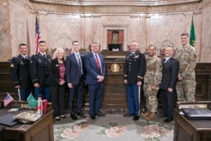Washington State Representative Jeremie Dufault, who is also an Army Reserve Officer with the 364th Sustainment Command (Expeditionary), and members of the House of Representatives, hosted a brief ceremony at the State Capitol in Olympia, where they presented a 'Letter of Recognition' honoring the Army Reserve on its 111th anniversary to Army Reserve Ambassador Mr. Kurt Harding, Mr. Herold Hudson, Command Executive Officer and representative for Commanding General Brig. Gen. Vincent E. Buggs, and Col. Kyle Myers, Chief of Operations for the 364th ESC.
