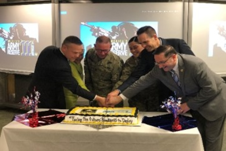 The 364th Sustainment Command (Expeditionary) hosted a cake-cutting ceremony in celebration of this year's Army Reserve birthday, where the youngest and most senior Soldiers were joined by the guests of honor, including Mr. Christopher Larsen, Military Liaison and Community Outreach and representative for Congressman Rick Larsen, the Hon. Jon Nehring, Mayor of the City of Marysville, and Mrs. Mary Miller, Army Reserve Ambassador for Washington State.