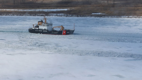 The crew of Coast Guard Cutter Hollyhock, a 225-foot sea-going buoy tender home-ported in Port Huron, Mich., breaks through the ice in the St. Clair River, Feb. 26, 2014. There are nine ice-breaking capable cutters home-ported in the Great Lakes region.