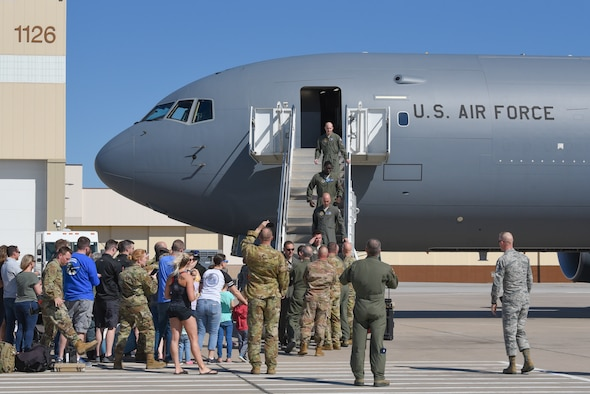 Members of Team McConnell exit a KC-46A Pegasus April 20, 2019, at McConnell Air Force Base, Kan. This is the fifth KC-46 to be delivered to McConnell. It is the first Pegasus delivery to have an aircrew composed of both active duty and reserve pilots from the 22nd and 931st Air Refueling Wings. (U.S. Air Force photo by Airman 1st Class Alexi Myrick)
