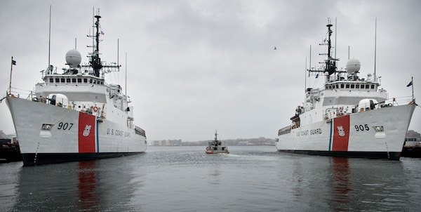 A Coast Guard Station Boston crew transits between Coast Guard Cutter Escanaba and Coast Guard Cutter Spencer in Boston on Nov. 24, 2014. The Escanaba and Spencer are 270-foot Famous-class medium endurance cutters.