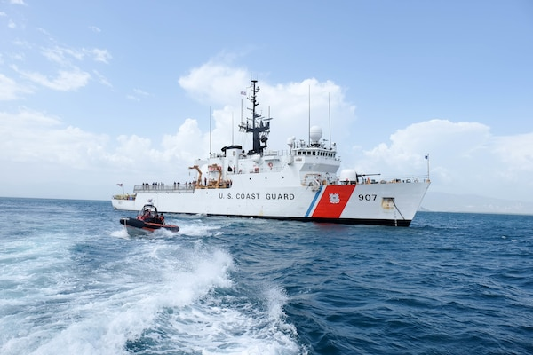 The Coast Guard Cutter Escanaba, a 270-foot medium endurance cutter homeported in Boston, and Escanaba's small boat are underway for a personnel transfer offshore Haiti Wednesday, July 27, 2016. The cutter's crew hosted Brian Shukan, deputy chief of mission at the U.S. Embassy in Haiti, and Michel-Ange Gedeon, director general of the Haitian National Police, for discussion of international search and rescue coordination and a tour of the cutter.