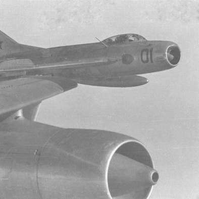 A Soviet MiG-19 Farmer D less than 20 feet off the wing of an RB-47H on 24 September 1962. Soviet pilots were extremely aggressive and occasionally flew directly in front of the RB-47's engines.