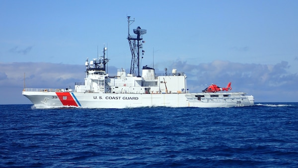 The Coast Guard Cutter Alex Haley is pictured before a Bering Sea patrol with a Coast Guard Air Station Kodiak MH-66 Dolphin helicopter embarked on the stern of the cutter, July 27th, 2018.  During Bering Sea patrols the cutter's crew conducts boarding evolutions of the fishing fleet and can respond to search and rescue cases as needed.