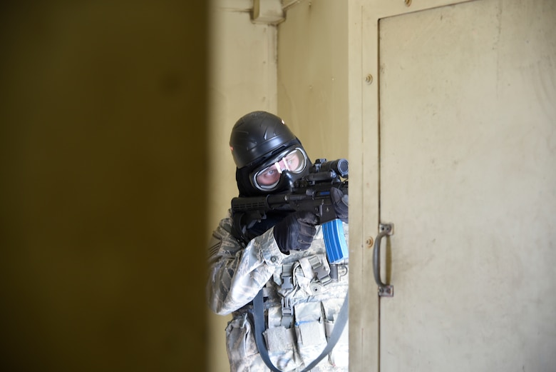 Master Sgt. Derek Roth, 114th Security Forces Squadron security forces member, hides out in a building while acting as an oppositional force during Military Operations in Urban Terrain (MOUT) training at Marine Corps Base Camp Pendleton, California.
