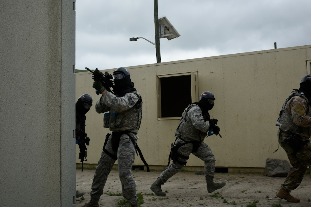 Tech. Sgt. Cody Lowe, 114th Security Forces Squadron security forces member, provides cover for fire team members during Military Operations in Urban Terrain (MOUT) training at Marine Corps Base Camp Pendleton, California.