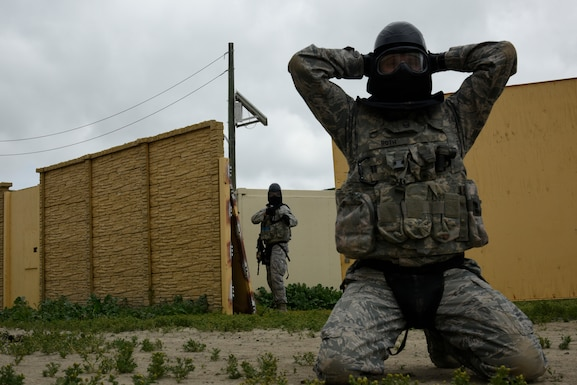 A Defender with the 114th Security Forces Squadron gives commands to an individual simulating an oppositional force during Military Operations in Urban Terrain (MOUT) training at Marine Corps Base Camp Pendleton, California.
