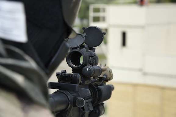 Tech Sgt. Adam Smith, 114th Security Forces Squadron security forces member, takes aim at an adjacent building to provide cover during Military Operations in Urban Terrain (MOUT) training at Marine Corps Base Camp Pendleton, California.