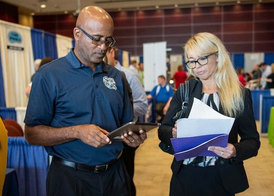 Naval Surface Warfare Center Panama City Division New Professional Development Coordinator Lanshava Booker speaks to prospective recruits at a job fair hosted at Florida State University Panama City April 25.