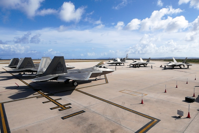 F-22 Raptors park during their inaugural appearance during exercise Resilient Typhoon, at the Francisco C. Ada International Airport, Saipan, April 23, 2019.