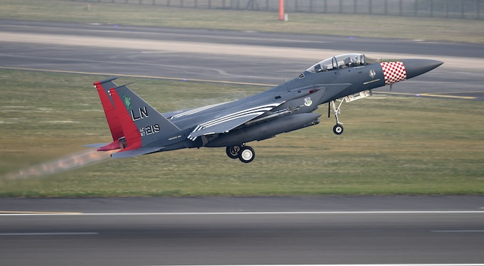 An F-15E Strike Eagle painted in the 492nd Fighter Squadron's heritage colors, inspired by its P-47 Thunderbolt predecessor, takes off from the flight line at Royal Air Force Lakenheath, England, April 24, 2019. The 48th Fighter Wing is participating in a readiness exercise from 23-25 April focused on continuous operations over a 48-hour period. (U.S. Air Force photo by Airman 1st Class Madeline Herzog)