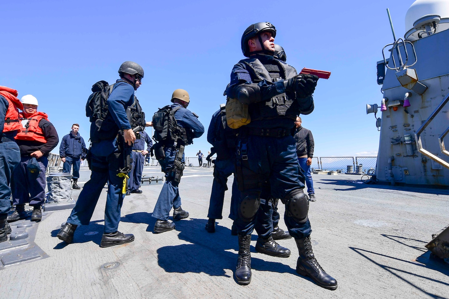 U.S. Navy and Georgian Coast Guard sailors board the Arleigh Burke-class guided-missile destroyer USS Ross (DDG 71)