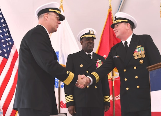 IMAGE: DAHLGREN, Va. (April 24, 2019) - Capt. (sel) Stephen 'Casey' Plew, right, commanding officer of the Naval Surface Warfare Center Dahlgren Division (NSWCDD), shakes hands with Rear. Adm. Eric Ver Hage, commander of the Naval Sea Systems Command (NAVSEA) Warfare Centers, moments after formally assuming command of NSWCDD during a change of command ceremony. Looking on is Capt. Godfrey 'Gus' Weekes, outgoing NSWCDD commanding officer.