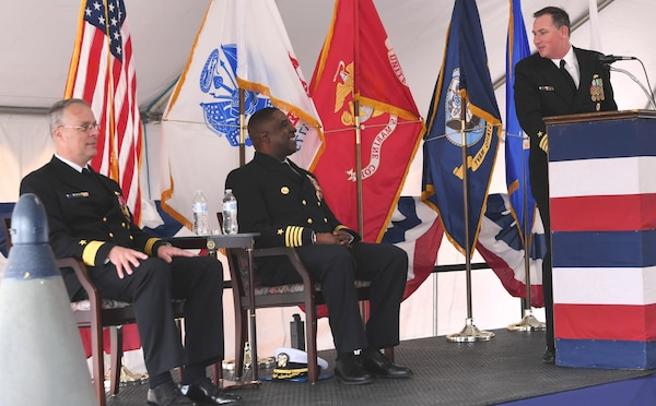 IMAGE: DAHLGREN, Va. (April 24, 2019) - Capt. (sel) Stephen 'Casey' Plew, right, commanding officer of the Naval Surface Warfare Center Dahlgren Division (NSWCDD), shares a light moment during his assumption of command remarks with Capt. Godfrey Weekes, outgoing NSWCDD commanding officer, middle, and Rear. Adm. Eric Ver Hage, commander of the Naval Sea Systems Command (NAVSEA) Warfare Centers, during a change of command ceremony.