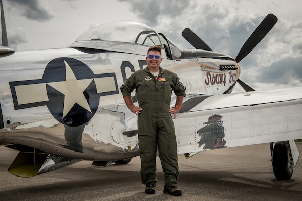 "Robert ""R.T."" Dickson Jr. poses with ""Swamp Fox,"" his restored P-51 Mustang aircraft, on the flight line of the Kentucky Air National Guard Base in Louisville, Ky., April 11, 2019. This exact aircraft was once assigned to the Kentucky Air Guard when the Mustang served as the unit's primary airframe from 1947 to 1953. (U.S. Air National Guard photo by Staff Sgt. Joshua Horton)"