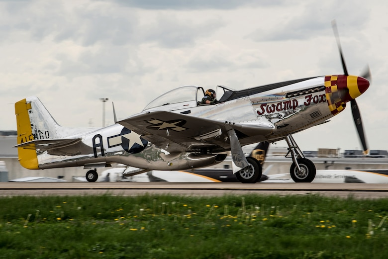 """Robert """"R.T."""" Dickson Jr. arrives at the Kentucky Air National Guard Base in Louisville, Ky., April 11, 2019, with """"Swamp Fox,"""" his restored P-51 Mustang aircraft. The aircraft, which was in town to fly in the 2019 Thunder Over Louisville air show, was once assigned to the Kentucky Air Guard when the Mustang served as the unit's primary airframe from 1947 to 1953. (U.S. Air National Guard photo by Staff Sgt. Joshua Horton)"""