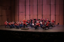 On April 14, 2019, the Marine Chamber Orchestra, conducted by Assistant Director Capt. Ryan J. Nowlin, performed Johann Sebastian Bach's Suite No. 4 in D, BWV 1069; Wolfgang Amadeus Mozart's Horn Concerto No. 2 in E-flat, K. 417; and Joseph Haydn's Symphony No. 103, Drum Roll. The concert took place at the Rachel M. Schlesinger Concert Hall and Arts Center at Northern Virginia Community College in Alexandria, Va. (U.S. Marine Corps photo by Master Sgt. Kristin duBois/released)
