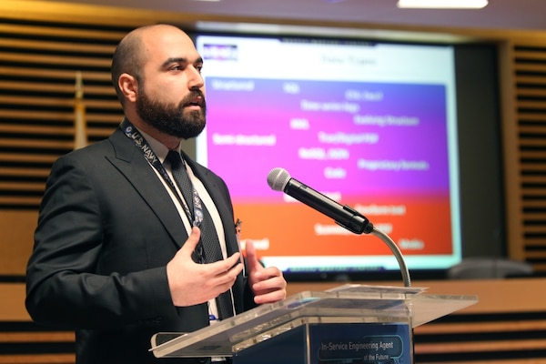 Naval Surface Warfare Center, Corona Division mechanical engineer Hovanes Keseyan discusses data solutions with members of industry and education