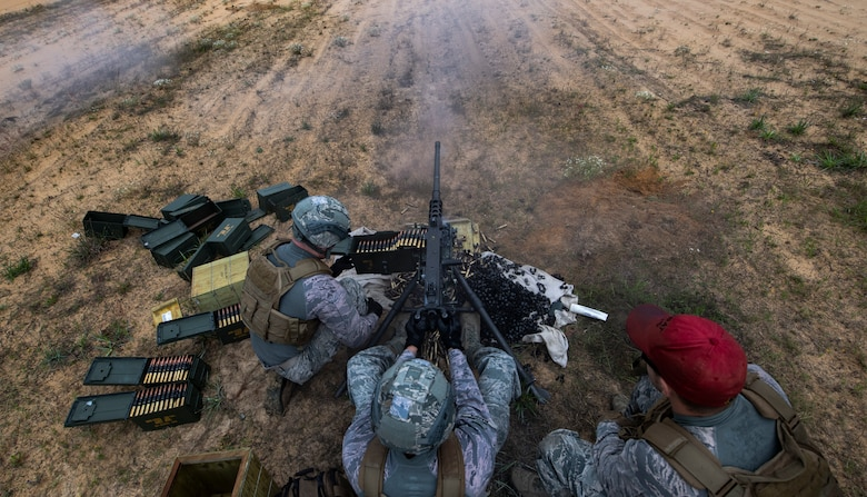 Airmen fire a Browning M2 machine gun