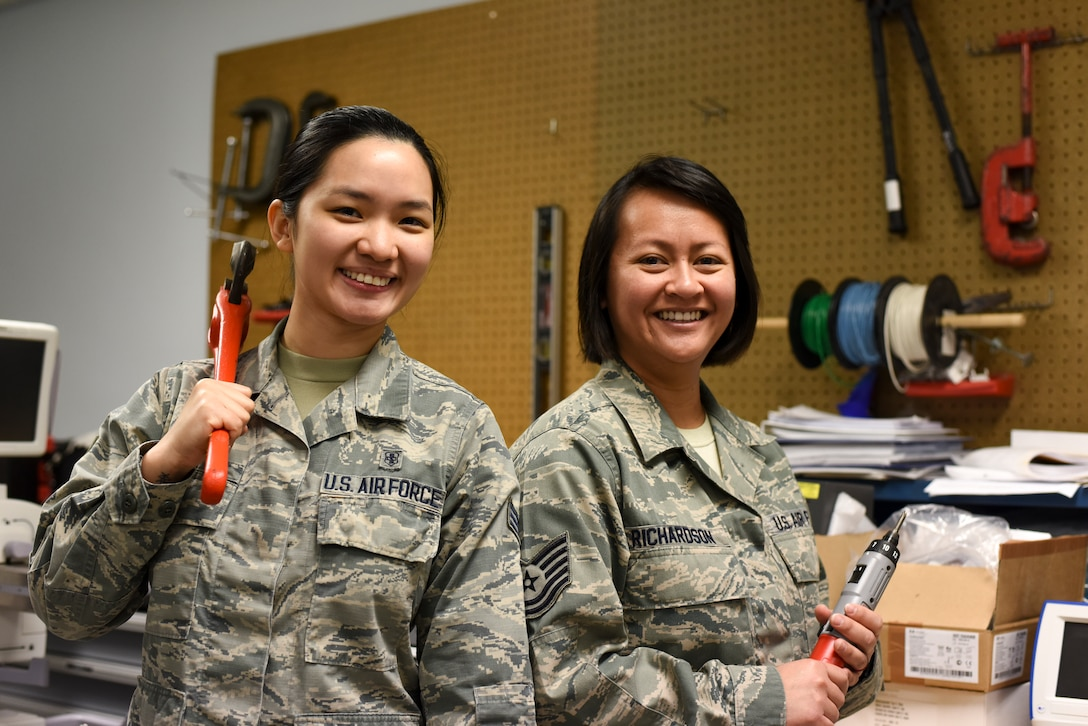 Tech. Sgt. Kristine Richardson, 39th Medical Support Squadron biomedical equipment NCO in charge, right, and Senior Airman Kirsten Lee, 39th MDSS biomedical equipment technician, left, pose for a photo April 18, 2019, at Incirlik Air Base, Turkey.