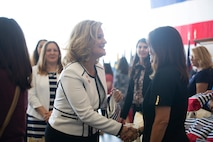 Mrs. Rebecca Cederholm, the U.S. Marine Corps Forces Command Deputy Commander's wife, receives a care package from Second Lady of the United States Karen Pence during a town hall event honoring active-duty spouses at Naval Station Norfolk, Norfolk, Virginia, April 24, 2019. The town hall was held to honor military spouses and children of deployed or deploying service members. During her visit, Second Lady Pence delivered care packages, spoke with spouses, and highlighted the programs and services that military service organizations such as the USO provide. (U.S. Marine Corps photo by Sgt. Jessika Braden/released