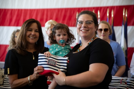 Second Lady of the United States Karen Pence meets with a military spouse and her daughter at the conclusion of a town hall event honoring active-duty spouses at Naval Station Norfolk, Norfolk, Virginia, April 24, 2019. The town hall was held to honor military spouses and children of deployed or deploying service members. During her visit, Second Lady Pence delivered care packages, spoke with spouses, and highlighted the programs and services that military service organizations such as the USO provide. (U.S. Marine Corps photo by Sgt. Jessika Braden/released)