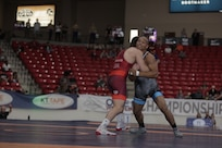 US Marine Sgt. Devin Hester wrestles Taylor Lamont during the US Marine Corps Open Wrestling Championships in Las Vegas, April 25, 2019. USA Wrestling, a representative of the United States Olympic Committee, is the central organization that coordinates amateur wrestling programs throughout the nation. The partnership between the US Marine Corps and USA Wrestling originated through shared principles such as discipline, physical fitness, aggressive attitude, and mental and physical toughness. The Marine Corps continues to support USA Wrestling to increase awareness and positive perception of the Corps while also informing athletes of opportunities they may have by serving in the force. (US Marine Corps photo by Cpl. Naomi May)