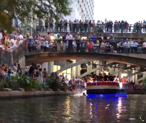 After he jumped off his barge, Tech Sgt. Ryan Fillweber races to save a woman who had fallen into the San Antonio River during the April 22 Texas Cavaliers River Parade. Fillweber is a military ambassador during the 2019 Fiesta San Antonio celebrations, which last from April 18 to April 28 and celebrate a variety of historic and cultural events across the city.