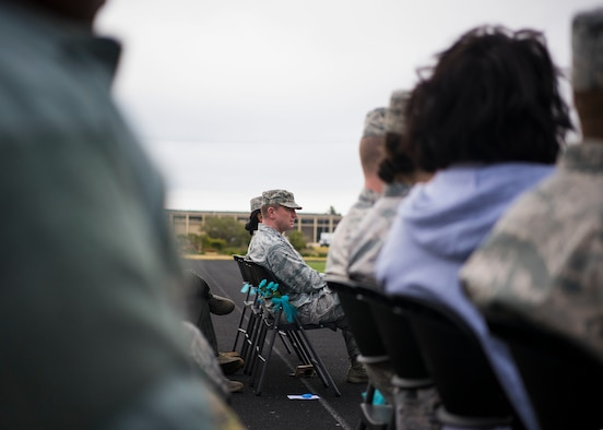 """Col. Bob Reeves, 30th Space Wing vice commander, listens as Edward Wilson, guest speaker, provides a spoken word performance during Sexual Assault Prevention and Response's Survivor Vigil April 19, 2019, at Vandenberg Air Force Base, Calif. The performance was part of the Difference Makers """"Cultivating Difference Makers"""" presentation. (U.S. Air Force photo by Airman 1st Class Hanah Abercrombie)"""