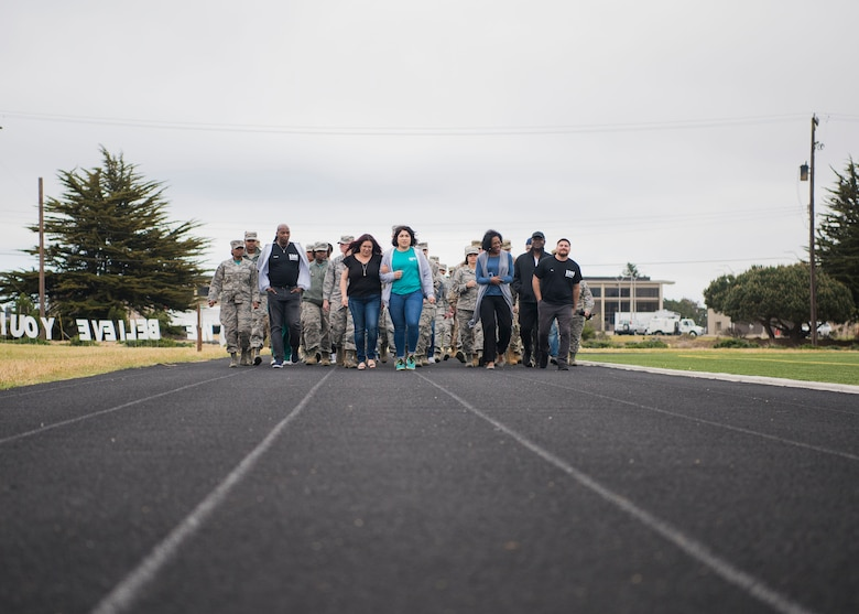 The members who attended during the Sexual Assault Prevention and Response's Survivor Vigil took a courtesy walk a lap of silence April 19, 2019, at Vandenberg Air Force Base, Calif. The walk around the track provided attendees with time to reflect on the stories shared during the ceremony and show support to those who have survived sexual assault. (U.S. Air Force photo by Airman 1st Class Hanah Abercrombie)