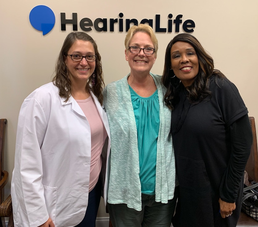 Dr. Linnea Herbert, Lynn Hill and Martha Johnson take time for a photo following the fitting of Hill's government-funded hearing aid. (Courtesy photo)