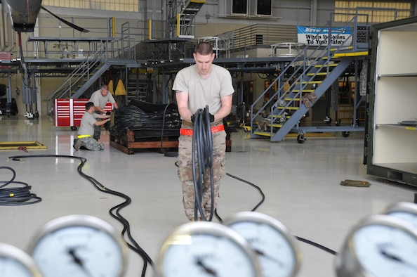 Tech. Sgt. Timothy Stevenson, 403rd Maintenance Squadron hydraulics back shop technician, unrolls a hose to attach to the air bags used to lift an aircraft. As a member of the 403rd Wing Crash, Damaged or Disabled Aircraft Recovery team, he participated in the annual training that is required to maintain proficiency and ensure that all equipment is serviceable and operational.  The CDDAR training was held during the March Unit Training Assembly at Keesler Air Force Base.   (U.S. Air Force photo by Master Sgt. Jessica Kendziorek)