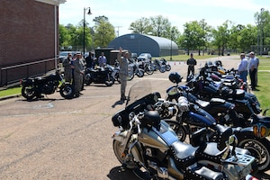 Chaplain (Maj.) Bradley Kimble, 14th Flying Training Wing deputy chaplain, speaks to Airmen arriving for Blessing of the Bikes April 24, 2019, on Columbus Air Force Base, Miss. The event was held to bring together Airmen and those alike to meet and greet one another as well as to pray for the safe journeys of the riders. Airmen had a chance to listen to the words of the chaplain while still voicing their concerns and opinions related to motorcycle services on base. (U.S. Air Force photo by Airman 1st Class Jake Jacobsen)