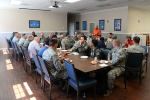 John Lindell, 14th Flying Training Wing occupation safety manager, speaks to Airmen during lunch at the Blessing of the Bikes event in the chapel April 24, 2019, on Columbus Air Force Base, Miss. The motorcycle safety briefing is a course that Airmen get credit for attending and shows incentive to follow the rules and regulations of motorcycle riding in the military. The event was held to bring together Airmen and those alike to meet and greet one another as well as to pray for the safe journeys of the riders. (U.S. Air Force photo by Airman 1st Class Jake Jacobsen)