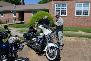 Chaplain (Lt. Col.) Steven Richardson, 14th Flying Training Wing chaplain, and Master Sgt. Ryan Johnson14th Force Support Squadron career assistance advisor, pray together during the Blessing of the Bikes April 24, 2019, on Columbus Air Force Base, Miss. The blessing of the bikes is a spring tradition that is held in the military as well as the civilian world in which motorcycle riders can be blessed in the hope it will bring safety for future travels. The event was a way to further the mission here at Columbus AFB by allowing the chaplains to connect with people in a different setting than usual. (U.S. Air Force photo by Airman 1st Class Jake Jacobsen)