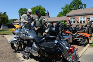 Col. Gary Hayward, 14th Mission Support Group commander, and Chaplain (Maj.) Bradley Kimble, 14th Flying Training Wing deputy chaplain, pray together during the Blessing of the Bikes April 24, 2019, on Columbus Air Force Base, Miss. The event is a tradition that is held in the military as well as the civilian world, in which motorcycle riders can be blessed in the hope it will bring safety for future travels. Motorcyclists from all ranks and units came to the chapel to be a part of the blessing and eat lunch with other like-minded people. (U.S. Air Force photo by Airman 1st Class Jake Jacobsen)