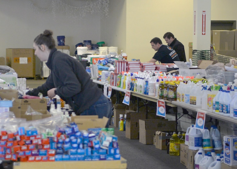 Members of the community stock shelves at the Sarpy-Cass Disaster Resource Center April 4, 2019, in Bellevue, Nebraska. The counties were heavily impacted by flooding in early March. (U.S. Air Force photo by D. P. Heard)