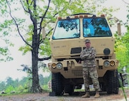 Sgt. Jacob Mason, a motor vehicle operator with the 1257th Transportation Company, poses for a photo in front of a vehicle he operates. Mason was selected as the West Virginia Army National Guard's Soldier Spotlight for April. (Courtesy Photo)
