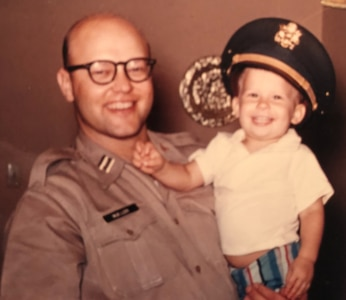 Army Capt. (Dr.) Arnold Mueller holds 2-year-old Steve Mueller. Steve Mueller was born in old-BAMC when his father was stationed at BAMC in 1958.