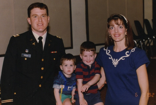 Army Capt. (Dr.) Scott Murtha with sons ,Kevin and Andy, and wife Jeani, at his residency graduation ceremony at Brooke Army Medical Center in June 1992. Air Force Capt. (Dr.) Andrew Murtha was born at old BAMC in 1989 and is now completing his residency at BAMC.