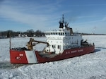 The Coast Guard Cutter Mackinaw, a 240-foot heavy icebreaker, breaks ice near Marine City, Mich., along the St. Clair River, Jan. 28, 2015. The cutter was operating as part of Operation Taconite, which is the ice breaking operation for the northern Great Lakes.