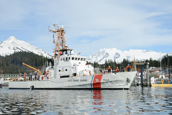 The crew of the Coast Guard Cutter Liberty prepares to moor at their homeport of Juneau, Alaska, March 13, 2018. The crew of the Cutter Liberty, a 110-foot patrol boat homeported in Juneau, Alaska, was completing tailored ship's training availability, a biennial readiness assessment of the cutter and crew.