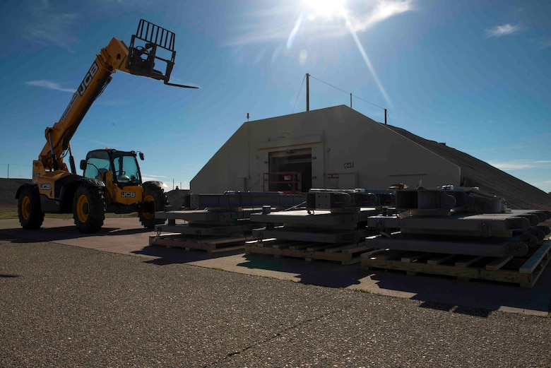 The 366th Munitions Squadron storage area is undergoing construction on seven of its Earth Covered Magazines (ECM), April 23, 2019 at Mountain Home Air Force Base, Idaho. Four out of seven igloos were condemned and unusable since 2010 due to safety hazards from deterioration of the doors. (U.S Air Force photo by Airman 1st Class JaNae Capuno)