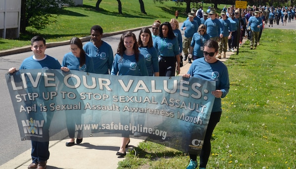 "Supporters of Sexual Assault Awareness and Prevention Month from NSA Philadelphia and its tenant commands, including DLA Troop Support, create a ""sea of teal"" on their annual awareness walk across the installation April 23, 2019 in Philadelphia."