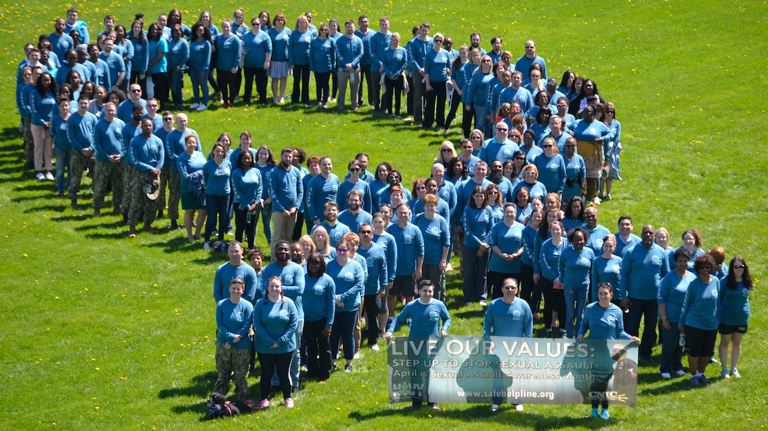 """Supporters of Sexual Assault Awareness and Prevention Month from NSA Philadelphia and its tenant commands, including DLA Troop Support, create a """"sea of teal"""" on their annual awareness walk across the installation April 23, 2019 in Philadelphia."""