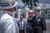 U.S. Navy Adm. Craig Faller, commander of U.S. Southern Command, renders honors upon arrival to meet with Ecuador's Minister of Defence, General Oswaldo Jarrín.